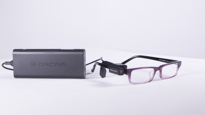 The OrCam has a tiny camera mounted on the spectacle frame and an audio link to read print.