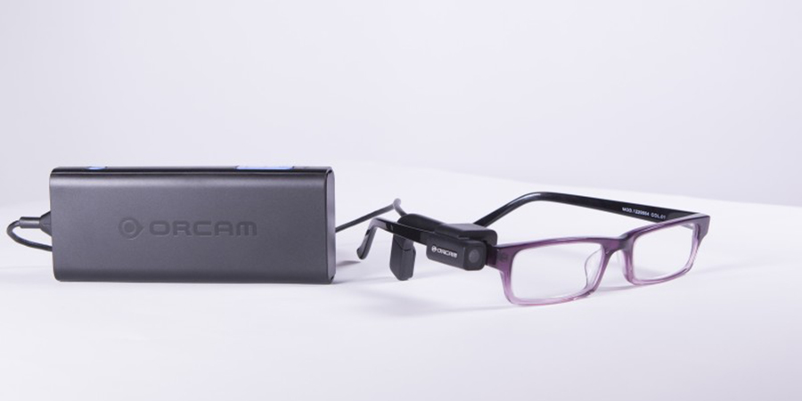 The OrCam  has a tiny camera mounted on spectacles  and a audio feed for reading print to you.