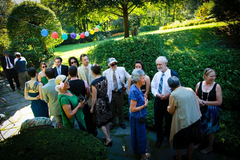 A crowd of guests at an outdoor wedding.