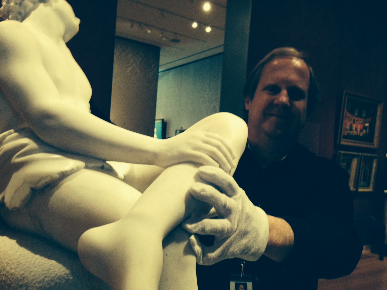 David Kingsbury is a guide at the MFA. Here are his hands wearing white gloves, feeling his favorite sculpture The Sleeping Faun by Harriet Hosmer.
