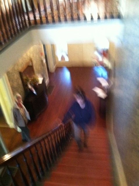 A very blurred figure is approaching up the stairs. It might be a woman. But do you know her?