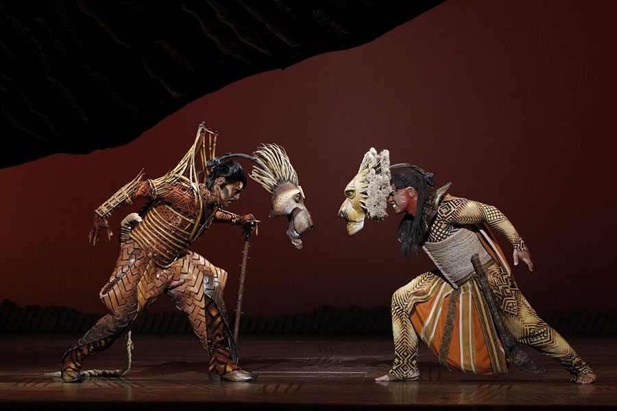 Simba the Lion King faces the evil Scar in the current production of This is the Lion King