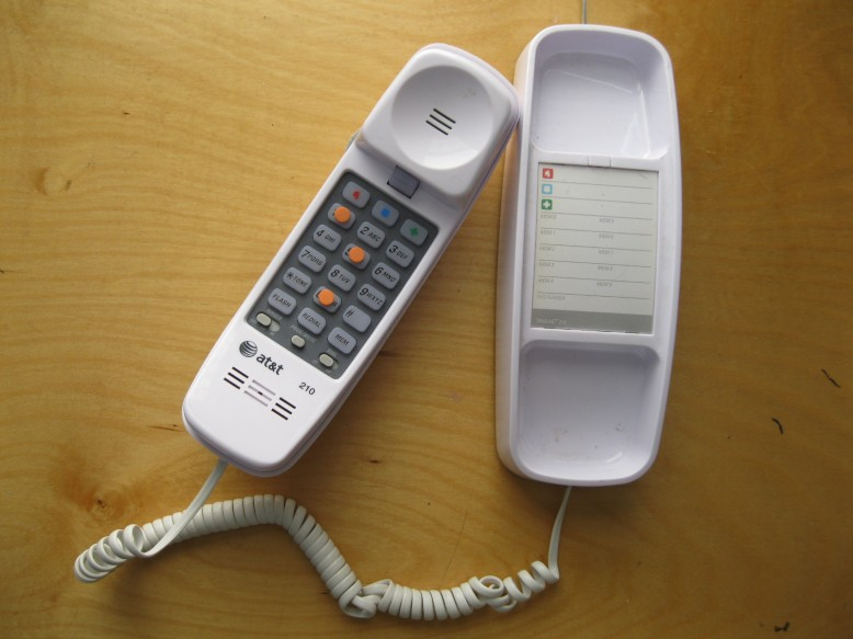 Old style princess phone, with some bump dots on the number pad. You don't need a cordless phone or a cell phone for this.