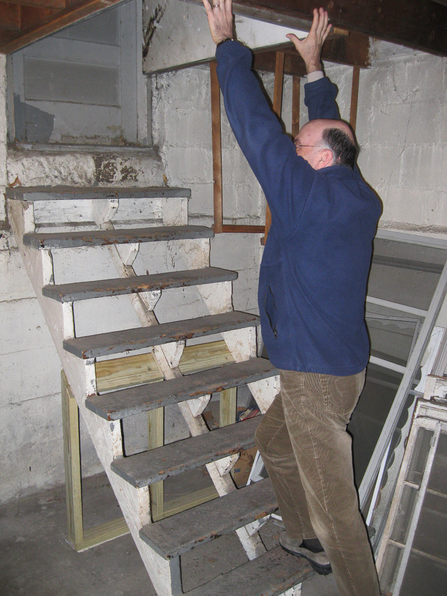 Joe Kolb standing on our basement bulkhead steps demonstrating how hazardous they are without a railing.