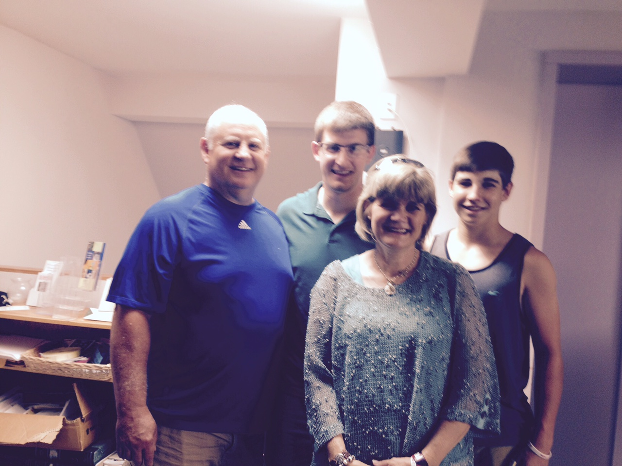 Christian , his parents and his younger brother Connor in June this year.