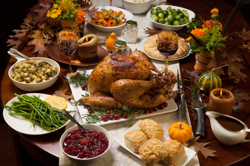 Roast Turkey surrounded by side dishes